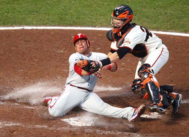 San Francisco Giants catcher Buster Posey tags out Philadelphia Phillies' Carlos Ruiz during Game 4 of their NLCS playoff series on Oct. 20 in San Francisco. The Giants won 6-5.