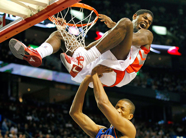 Toronto's Amir Johnson celebrates his slam dunk over New York's Anthony Randolph during the first half of their preseason game Oct. 22  in Montreal.  The Raptors defeated the Knicks 108-103.