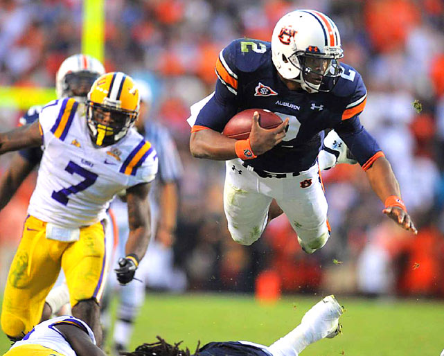Auburn Tigers quarterback Cameron Newton hurdles an LSU defender in Auburn's 24-17 victory on Oct. 23 at Jordan Hare Stadium in Alabama.