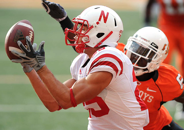 Tight end Kyler Reed of Nebraska makes a fingertip catch as cornerback Andrew McGee of Oklahoma State defends during their Oct. 23 matchup at Boone Pickens Stadium in Stillwater, OK. Nebraska defeated Oklahoma State 51-41.