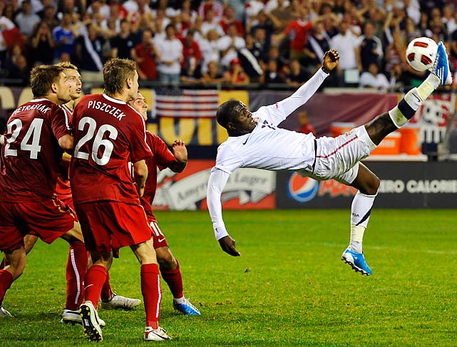 The Polish national team looks on in awe as the U.S.'s Jozy Altidore (right) attempts a bicycle kick on goal during the second half of the U.S.-Poland match on Oct. 9. The U.S. and Poland tied 2-2.