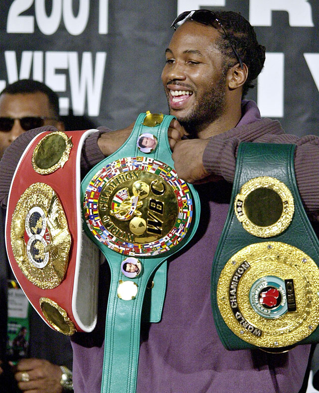 Lewis avenged a stunning knockout loss to Hasim Rahman with a fourth-round knockout to regain the heavyweight title.