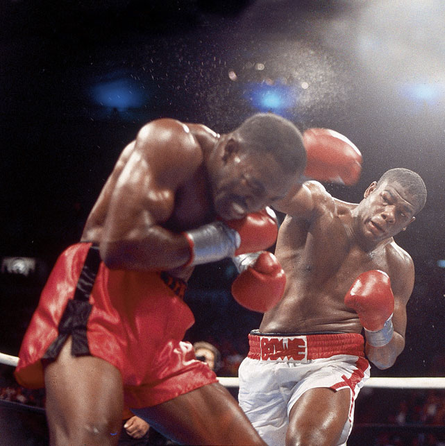 """Big Daddy"" Bowe won the undisputed heavyweight championship by a unanimous decision, handing Evander Holyfield his first career loss."