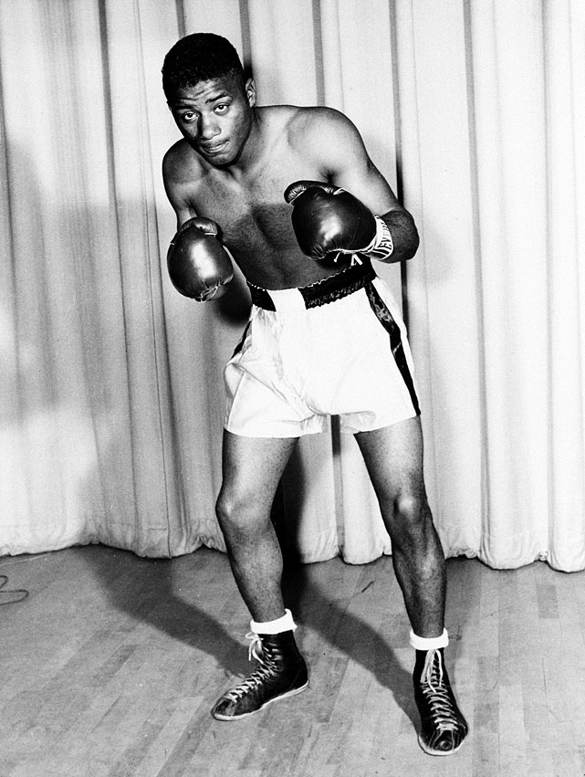 When Rocky Marciano retired in 1956 -- the second of three interruptions of the heavyweight title linage -- a six-man tournament was held to determine a recognized heavyweight champion. Patterson, a gold medalist at the 1952 Olympics in Helsinki, beat Archie Moore in the final to become the youngest world heavyweight champion in history at 21 years and 10 months. (The mark would later be broken by fellow Cus D'Amato protege Mike Tyson.)