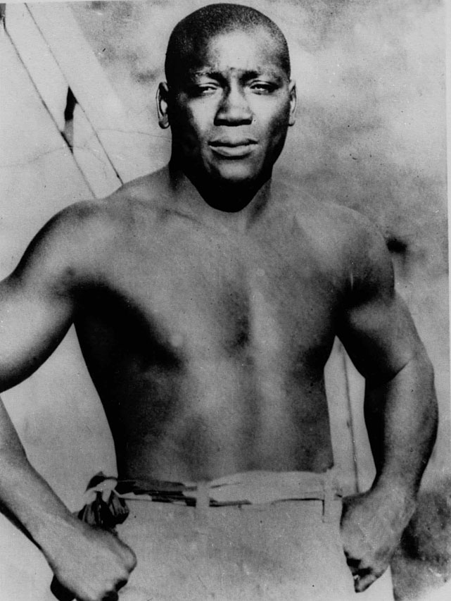 The Galveston Giant was the first African-American heavyweight champion and became a notorious figure for his brash and unapologetic demeanor outside the ring. One of the most brilliant defensive fighters in history, Johnson defeated Tommy Burns in Sydney after stalking him for two years in order to get a title shot.