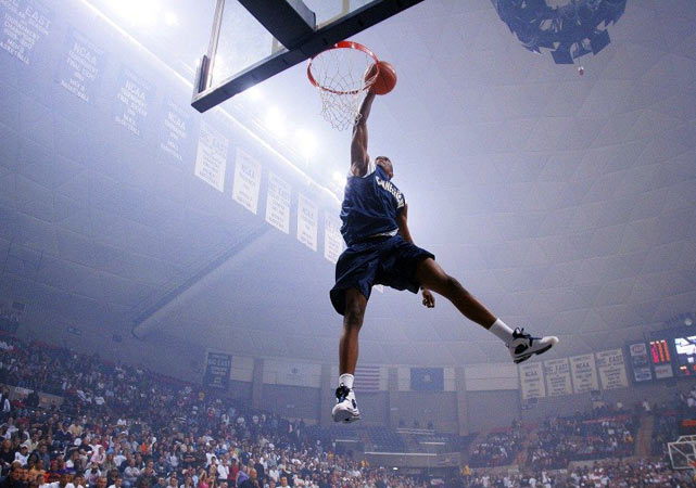 UConn freshman Rudy Gay participates in the slam dunk contest at the Huskies' 2004 Midnight Madness