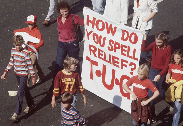 Philadelphia fans march with a sign in honor of Tug McGraw, their closer throughout the 1980 season.  McGraw was vital to the Phillies' run in the playoffs, racking up 15.2 innings in relief as the Phillies eliminated both the Astros and Royals.