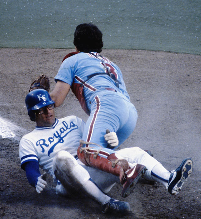 Royals' catcher Darrell Porter takes out opposing backstop Bob Boone the 1980 Fall Classic.  Though Porter upends Boone here, it was the Philadelphia catcher who got the last laugh, batting .412 with 4 RBIs during the Phillies' 4-2 World Series triumph.