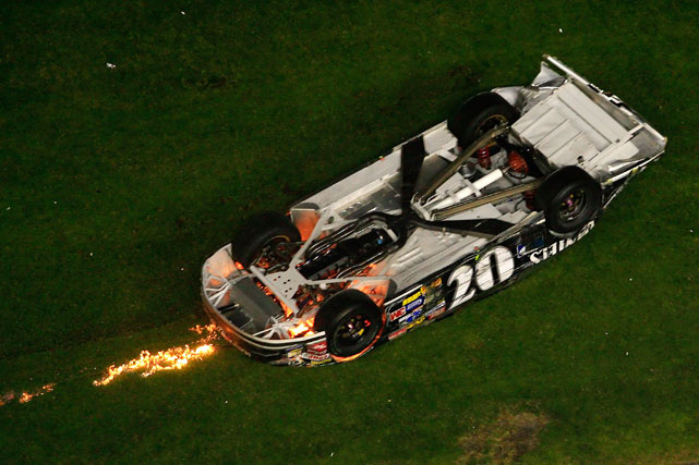 Bowyer's car ultimately slid into the grass and flipped right side-up allowing him to hop out unscathed.