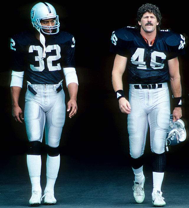 Raider greats Marcus Allen (left) and Todd Christensen march onto the field during Los Angeles' Sept. 20 matchup with New England.  Quite the duo, Allen and Christensen combined for 1,817 yards from scrimmage in only 12 regular season games.  Despite their success, the Raiders flopped to 5-10 and a fourth-place AFC West finish.