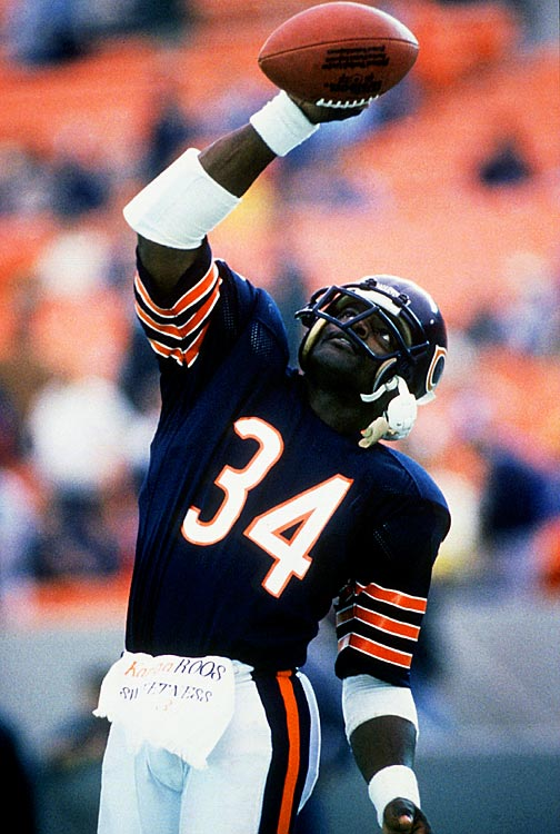 Walter Payton thrusts the football over his head in celebration during the Chicago Bears 1987 season, his last in the NFL.  Payton added 533 rushing yards to his then-record setting 16,726 total, and his Chicago Bears cruised to an 11-4 mark.