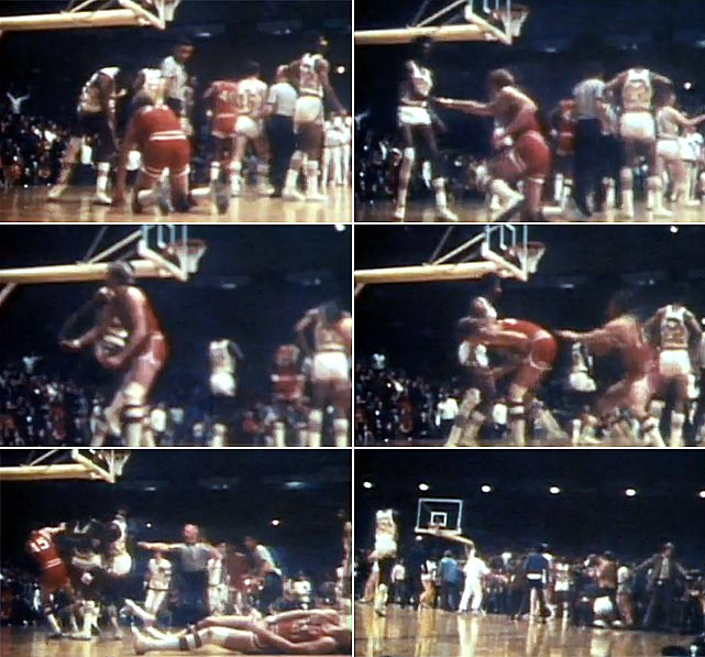"""The Buckeyes were leading Minnesota 50-44 with 36 seconds left when the Ohio State's Luke Witte was fouled hard and knocked down as he drove for a layup. Minnesota's Corky Taylor offered to help Witte up, only to knee him in the groin. As the teams began brawling, Gophers fans stormed the court and attacked the Buckeyes. Taylor and teammate Ron Behagen were suspended and Ohio's governor described the incident as """"Gang warfare in an athletic arena.""""    CLICK HERE  to watch the video."""