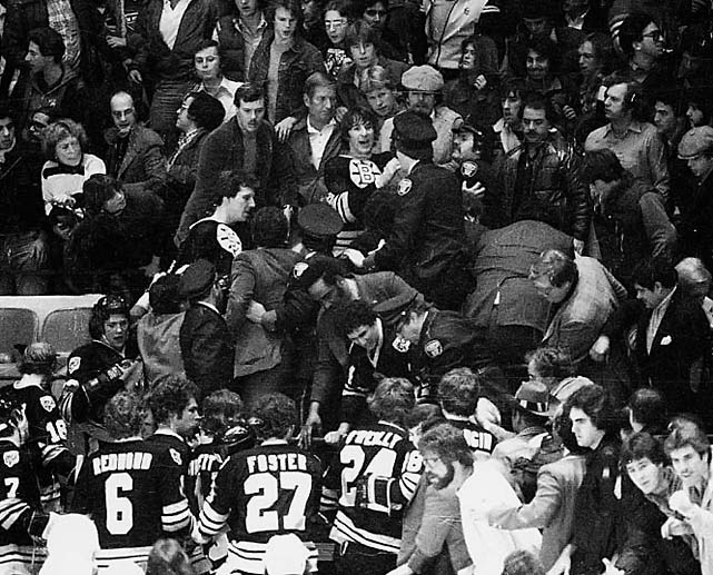As Boston's 4-3 victory ended with the Bruins exchanging words with several Rangers, fans at New York's Madison Square Garden started throwing stuff on the ice. When a fan hit winger Stan Jonathan and grabbed his stick, several Bruins, including captain Terry O'Reilly, Mike Milbury and Peter McNab climbed into the stands. Milbury pounded one fan with a shoe. Several other fans, including a woman, were punched or slapped. O'Reilly received an eight-game suspension, Milbury and McNab got six, and all were fined $500. The NHL was also moved to install higher glass around the rink.    CLICK HERE  to watch the video.