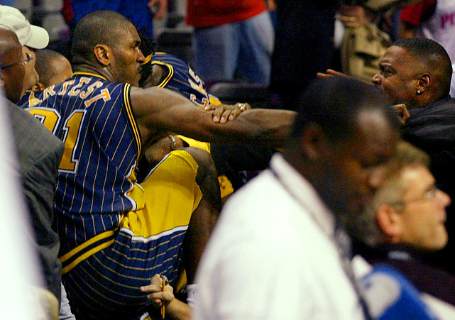 "The Malice at Palace remains the NBA's most infamous brawl between players and fans. During the final minute of their game, Ben Wallace of the Pistons and Ron Artest of the Indiana Pacers got into a shoving match that incited fans in Detroit's Palace at Auburn Hills to throw things onto the court. When Artest was hit, he and teammate Stephen Jackson charged into the stands, setting off a blizzard of punches, trash, beer, popcorn and even a chair. ""It's the ugliest thing I've seen as a coach or player,"" said Pistons coach Larry Brown, who tried to break up the battle. Artest received the longest suspension in NBA history: 73 games plus the playoffs. Jackson was banned for 30 games.    CLICK HERE  to watch the video."