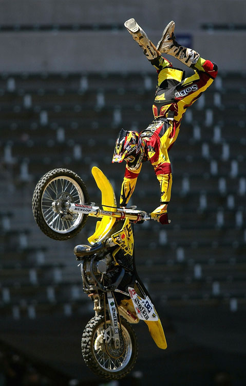 Pastrana clutches the handles of his bike as he performs a trick, just moments before he crashed during a 360 attempt.