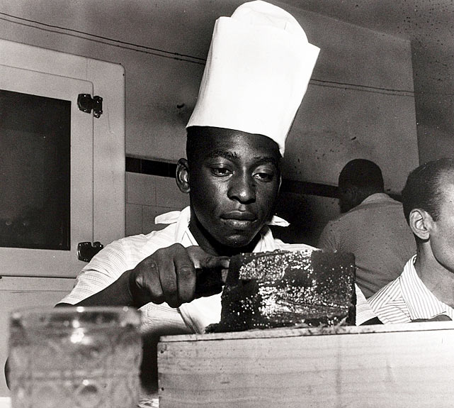 Pele does some cooking while sporting a chef's hat circa 1960.  He certainly knew the recipe for success, netting 1281 goals during his celebrated career.