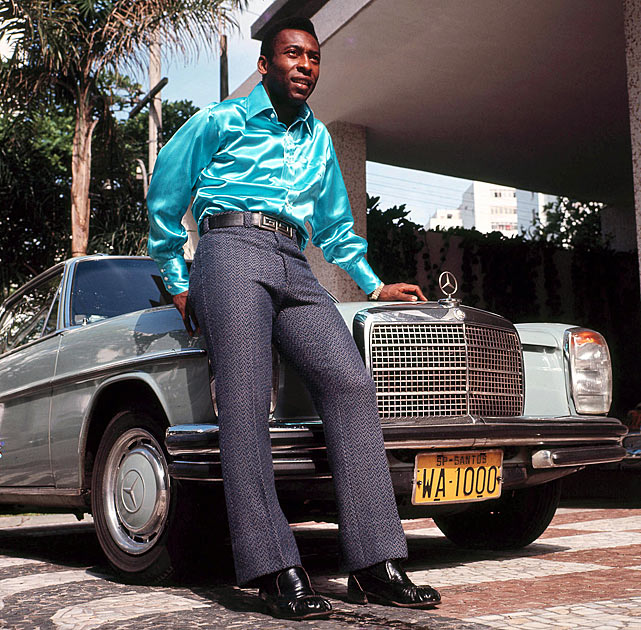 "A stylish Pele poses in front of a Mercedes-Benz in 1970.  His flashy image was fitting, as his on-field play earned him the nickname ""O Rei Pele,"" meaning ""The King Pele."""