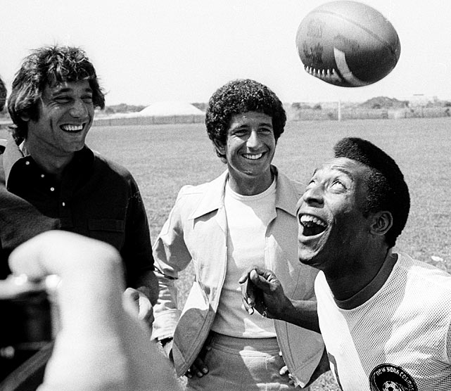 "During a ""Fabrege Promotional Event"" on Aug. 5, 1975, Pele juggles an American football.  His headers were quite amusing, drawing laughs out of spectators Joe Namath and designer Richard Barry."