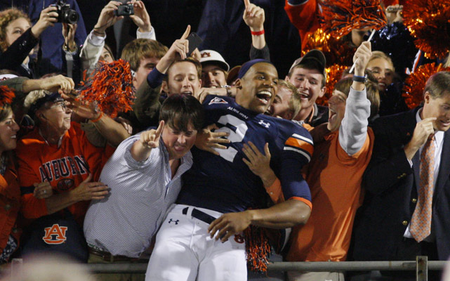 Cam Newton had plenty of reasons to celebrate Saturday. Auburn's star quarterback turned in another Heisman-worthy performance, throwing for two touchdown passes and catching another in No. 3 Auburn's victory over Mississippi. Newton failed to rush for 170 yards or more for the fifth consecutive game, but did pass for 199 while gaining 45 on the ground.