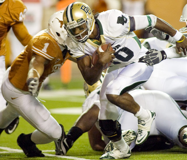 No. 25 Baylor added to reeling Texas' woes this season with a victory in Austin on Saturday. Quarterback Robert Griffin III (left) passed for two touchdowns and ran for another in leading the Bears to their first victory over the Longhorns since 1997.
