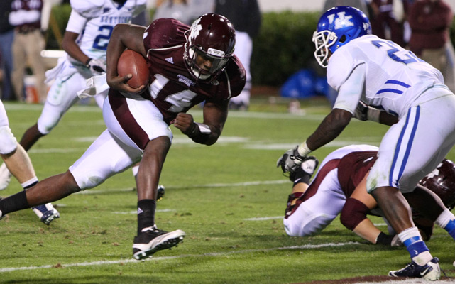 The Bulldogs used a fierce ground attack to edge the Wildcats on Saturday. Mississippi State running back Vick Ballard rushed for 103 yards and a touchdown and quarterback Chris Relf (left) ran for 79 yards and a score of his own in the 24-17 victory.