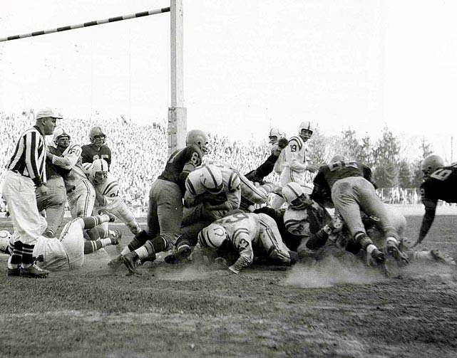 Baltimore Colts running back Alan Ameche vaults over the pile to score a touchdown in the 1957 season.