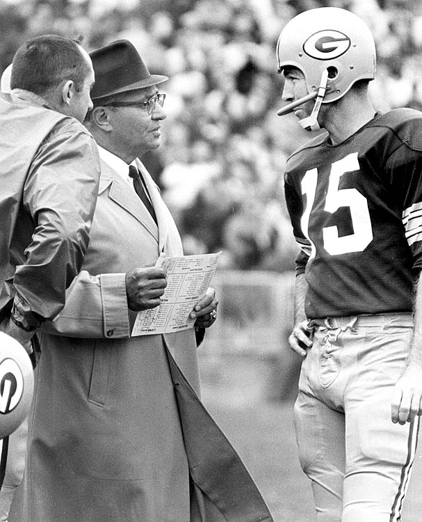Vince Lombardi and Bart Starr discuss strategy.