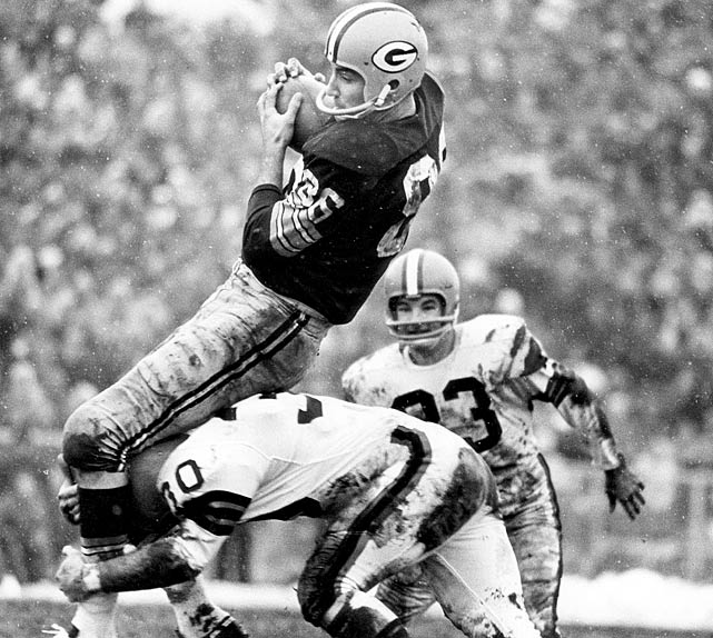 Packers wideout Boyd Dowder gets tripped up during the Green Bay's 23-12 triumph in the 1965 NFL Championship Game.