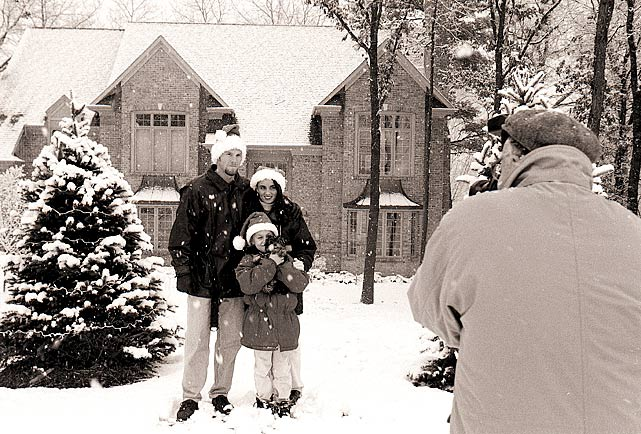 Biever (right) captures Brett Favre, his wife, Deanna, and daughter Brittany in front of their Green Bay home in 1996.