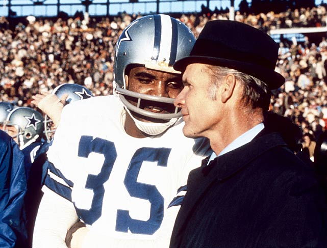Dallas coach Tom Landry confers with running back Calvin Hill during the Cowboys' Super Bowl VI victory over the Miami Dolphins.