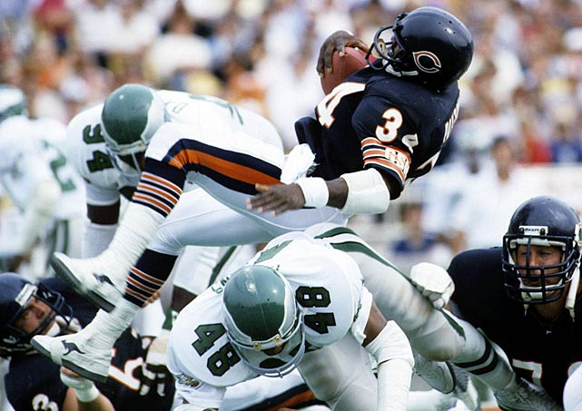 Walter Payton tumbles over Eagles' defender Wes Hopkins during a 1986 Bears' overtime win.