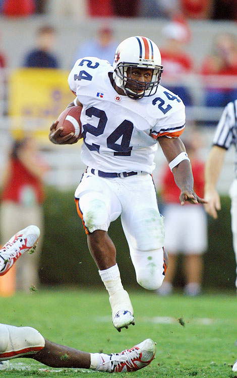 "With a combined 12 losses between the two teams, the 2003 Iron Bowl held little appeal for the casual fan.  But for those who did watch, they witnessed a masterful performance by Carnell ""Cadillac"" Williams, who opened the game with an 80-yard touchdown run.  Cadillac would finish with 204 rushing yards, and Auburn coach Tommy Tuberville lived to coach another day."