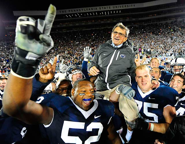 Penn State head coach Joe Paterno is carried by his players to the center of the field after winning his 400th game, a 35-21 victory over Northwestern.