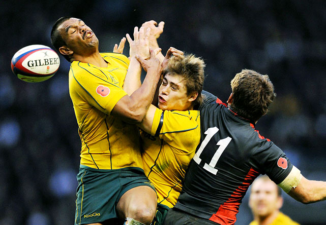 Australia's Kurtley Beale and James O'Connor collide as they jump for the ball against England's Mark Cueto during the Autumn International rugby union match Nov. 13 at Twickenham Stadium, southwest of London. England won  35-18.