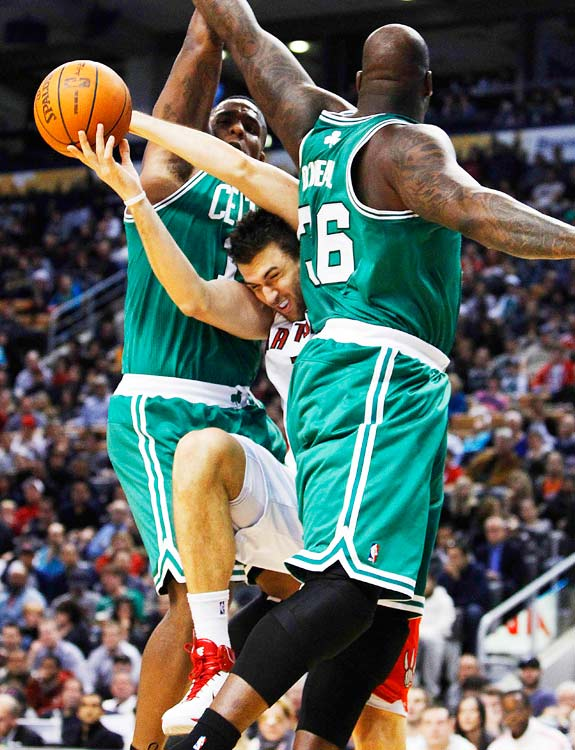 Toronto Raptors Andrea Bargnani breaks through Boston Celtics Shaquille O'Neal and Glen Davis during the second half of their game November 21 in Toronto.  The Raptors defeated the Celtics 102-101.