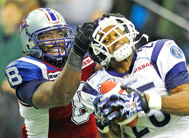 Montreal Alouettes Kerry Carter grabs the helmet of Toronto Argonauts Sean Smalls after Smalls intercepted a pass during the second half of their CFL East Division final game November 21 in Montreal.