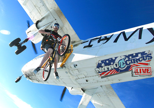 Nitro Circus stars Joelene Van Vugt of Canada, Erik Roner of the U.S. and eight friends perform some extreme skydiving maneuvers with a bike to launch their extreme sport  2011 Nitro Circus Live New Zealand Tour on November 16 in Matamata, New Zealand.