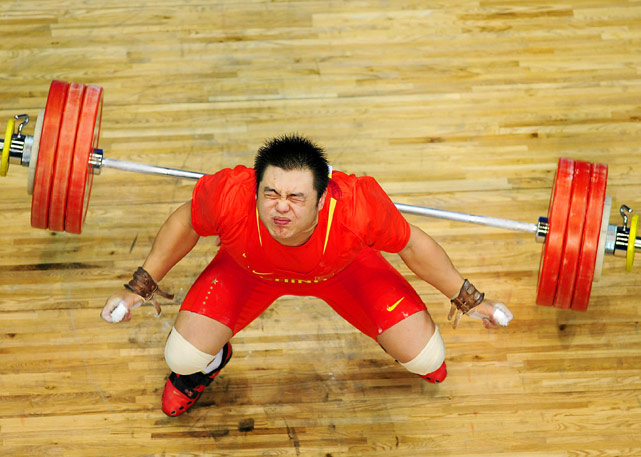 Yang Zhe of China reacts after winning the 105kg category weightlifting competition at the 16th Asian Games.