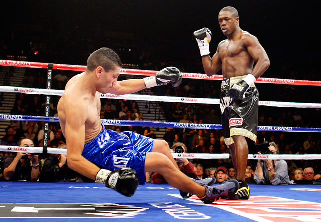 WBC welterweight champion Andre Berto (right) of the U.S. knocks out Freddy Hernandez of Mexico City during the first round of their title fight Nov. 27 at the MGM Grand Garden Arena in Las Vegas.