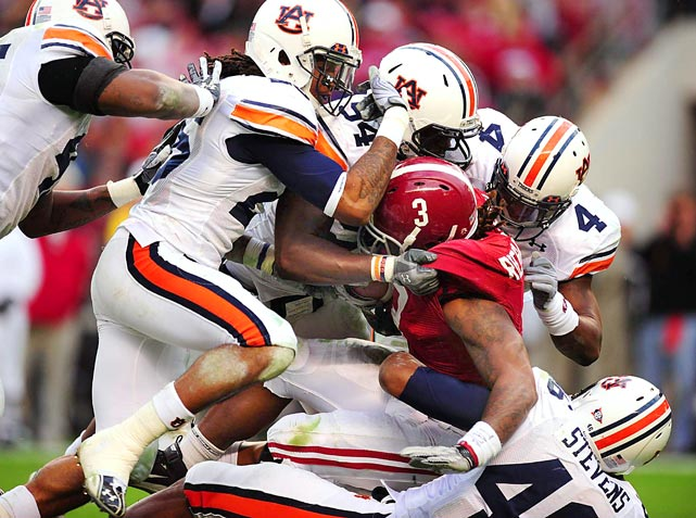 Auburn's defense stops Alabama running back Trent Richardson during the Iron Bowl at Bryant-Denny Stadium in Tuscaloosa. Auburn defeated Alabama 28-27.