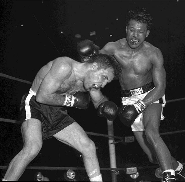 Longtime welterweight champion Robinson ( right ) moved up to challenge Jake LaMotta for the middleweight title on Feb. 14, 1951 -- a gruesome bout known darkly as the St. Valentine's Day Massacre. With a dazzling combination of speed and power, Robinson stopped LaMotta after 13 rounds in the sixth and final bout of their legendary series.