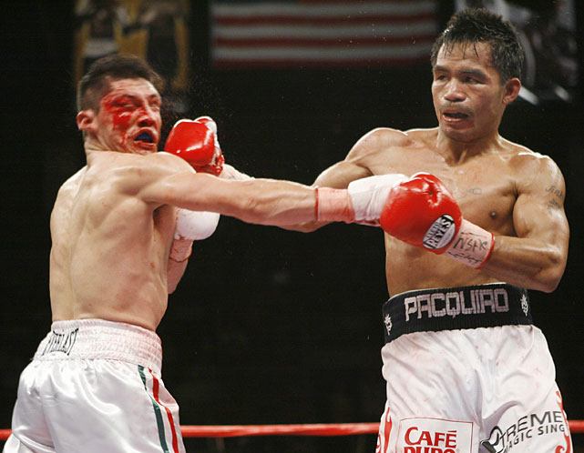 Pacquiao became a five-division champion with a ninth-round knockout of Diaz for the WBC lightweight title (135 pounds). He'd vacate the super featherweight title in July while mulling another move up in weight.