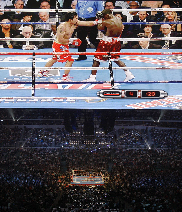 Pacquiao overwhelmed Clottey from wire to wire in his first defense of the WBO welterweight title before 50,994 fans at Cowboys Stadium. It marked the first boxing event at Jerry Jones' $1.3 billion palace. Only two fights in the United States during the past 50 years drew more fans: Muhammad Ali-Leon Spinks II at the New Orleans Superdome in 1978 (63,350) and Pernell Whitaker-Julio Cesar Chavez at San Antonio's Alamodome in 1993 (59,995).