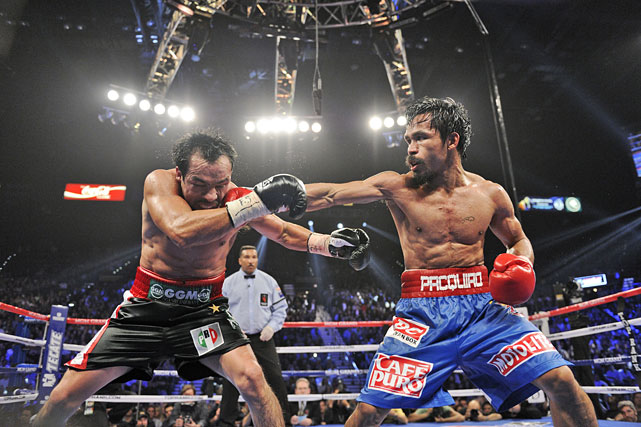Pacquiao showed great heart down to the stretch to rally for a majority-decision victory over the ageless Marquez, who entered as a 7-to-1 underdog despite narrow points losses to the Filipino in 2004 and '08. One ringside judge scored it 114-114, with the other two giving it to Pacquiao at 115-113 and 116-114. (SI.com had it 114-114.)