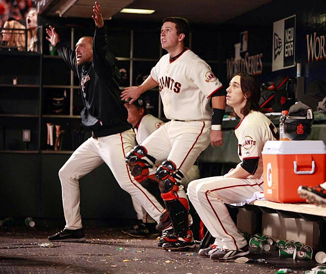 Mark Derosa, Buster Posey and Tim Lincecum look on as Juan Uribe homers during Game 1.  San Francisco cruised to a surprisingly high-scoring 11-7 win, setting the tone for the rest of the series.