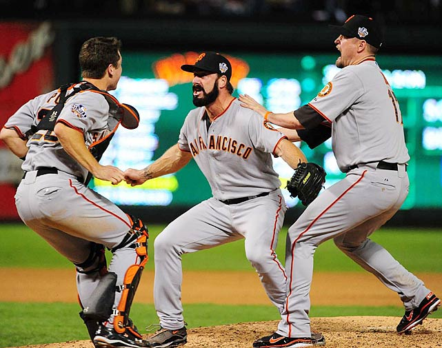 Buster Posey, Brian Wilson and Aubrey Huff rejoice after the final out is recorded, signaling the Giants first title since their move to San Francisco.  The battery of Wilson to Posey was especially effective, notching six saves and an 0.00 ERA during their memorable playoff run.