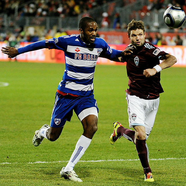 Rapids defender Drew Moor (right) fights for possession against FC Dallas striker Atiba Harris in the first half.