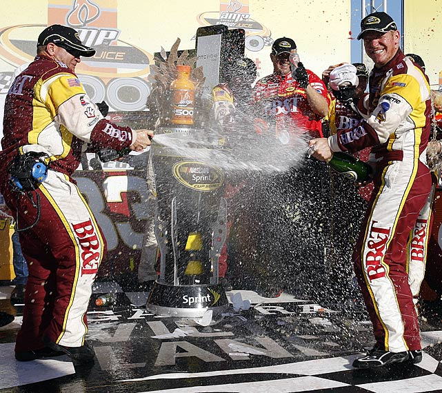 Bowyer and his crew celebrate the race's wild finish with some traditional champagne spraying on Victory Lane.