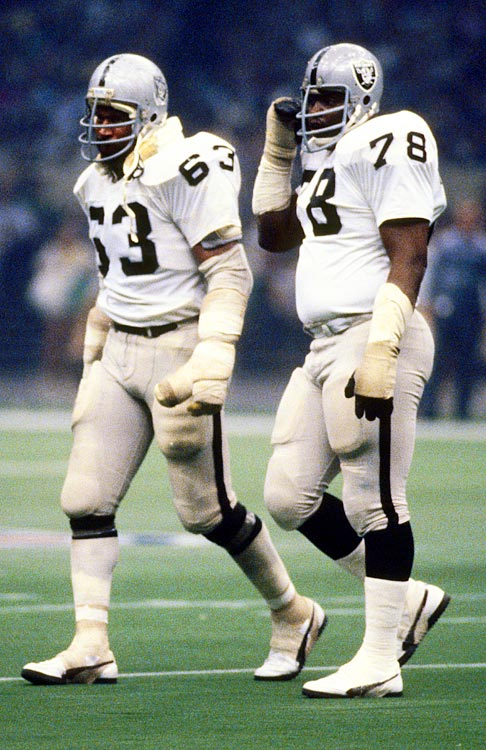 Art Shell and Gene Upshaw walk off the field during Super Bowl XV against Philadelphia. Upshaw, who spent his entire 15-year career with the Raiders, would become head of the NFL Players Association after his retirement.