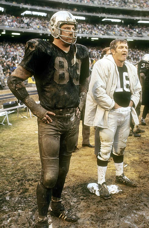 As the Raiders enjoy a resurgence on the field, SI looks back at some classic photos of the NFL's most notorious franchise  George Blanda (right) watches the action with Ben Davidson. Blanda spent nine seasons with the Raiders as a quarterback and placekicker while Davidson played defensive end for the franchise from 1964 to 1971.